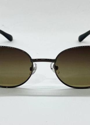 Солнцезащитные очки овальные серо-зеленые линзы с поляризацией с пластиковыми широкими дужками3 фото