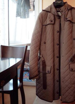 Утепленное стеганое пальто mango