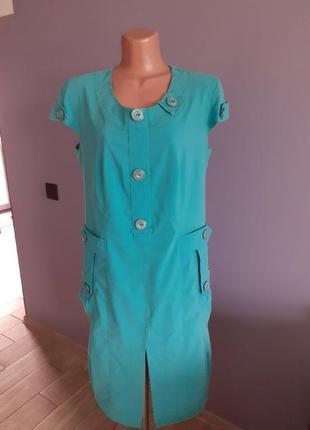 Платье бирюзового цвета .