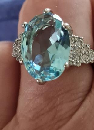 Родированное кольцо с голубым камнем
