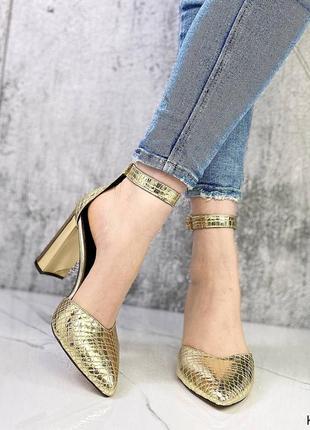 Шикарные женские кожаные золотистые  туфли лодочки с острым носком на каблуке