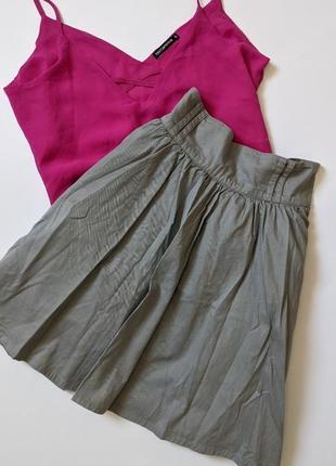 Серая пышная юбка с карманами