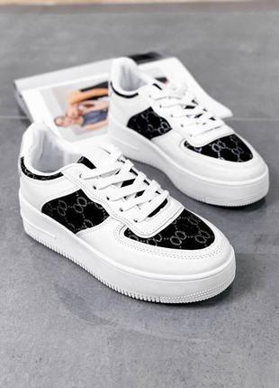 Черно белые кроссовки
