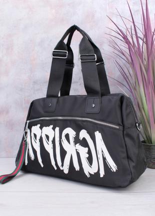 Женская чёрная спортивная сумка