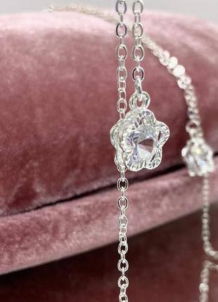 Цепочка держатель для очков серебристая белая с подвесками цветочки внутри с камнем