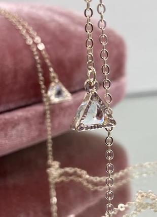 Цепочка держатель для очков золотистая с подвесками треугольники по бокам, внутри с камушками