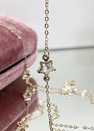 Золотистая цепочка держатель для очков с декором звёздочки, украшена камнями внутри