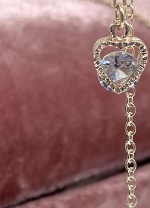 Цепочка держатель для очков золотистая с подвесками по бокам сердечки с камнями внутри