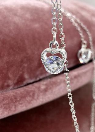 Цепочка для очков держатель серебристая белая с подвесками по бокам сердечки внутри камушки сверкают