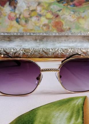 Стильные солнцезащитные женские очки в металлической оправе 20213 фото