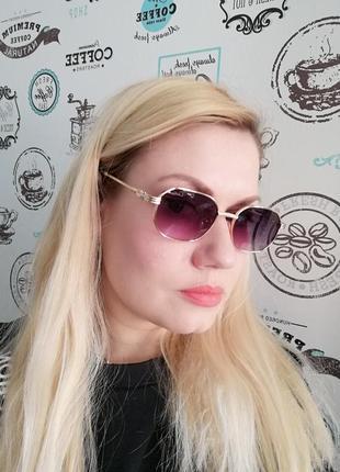 Стильные солнцезащитные женские очки в металлической оправе 20216 фото