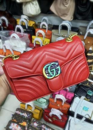 Красная кожаная брендовая сумка