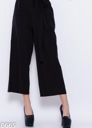 Вільні штани кюлоти чорного кольору1 фото