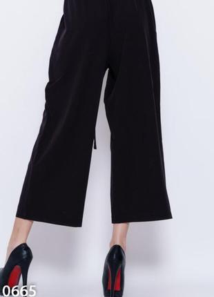Вільні штани кюлоти чорного кольору3 фото