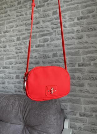 Яркая розовая сумка от juicy couture