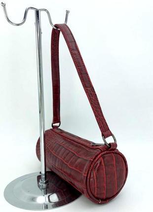 Женская молодежная сумка бочонок с текстурой крокодил aliri-65402 красного цвета