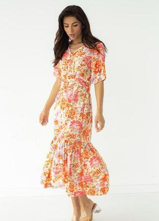 Помаранчева сукня з орнаментом