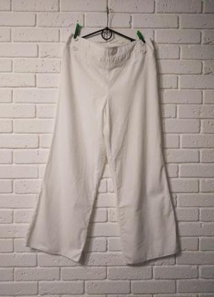 Лянные брюки палаццо