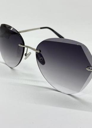 Женские солнцезащитные очки серые линзы с градиентом безоправные с цепочкой3 фото