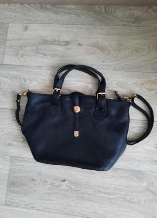 Стильная кожаная сумочка6 фото