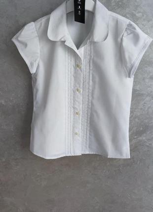 Нова біла блузка next розм. з 5 р./110 по 10 р./140