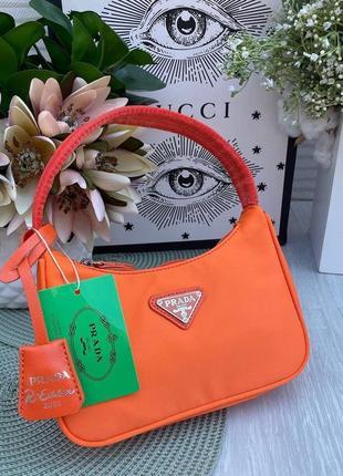Жіноча брендова сумочка в кольорах помаранчева
