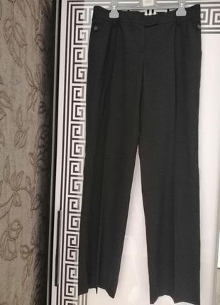 Штани темно синього, до чорного кольору, розмір виробника 14, нові з біркою.