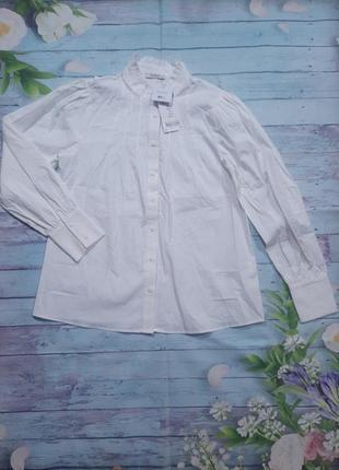 Нарядная белая блуза свободного кроя с обьемными рукавами