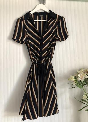 Платье в полоску по колено бренда stella margo