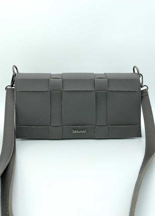 Женская сумка плетеная клатч