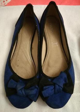 Туфлі.