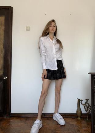 Полосатая мини юбка. короткая чёрная юбка в стиле школьницы urban outfitters6 фото