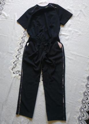 Стильный комбинезон с ьоковыми карманами1 фото