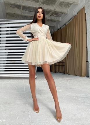Блестящее платье-мини с пышной юбкой и завязками на талии1 фото