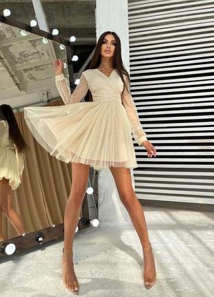 Блестящее платье-мини с пышной юбкой и завязками на талии2 фото