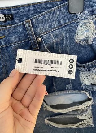 Короткие джинсовые шорты с рваностями дырками батал7 фото
