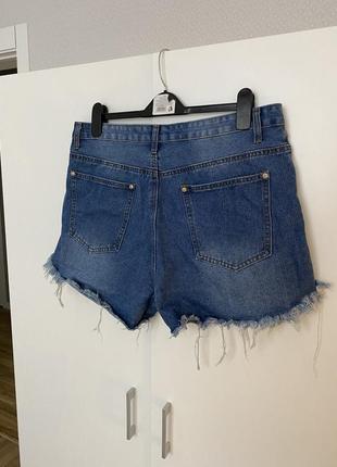 Короткие джинсовые шорты с рваностями дырками батал8 фото