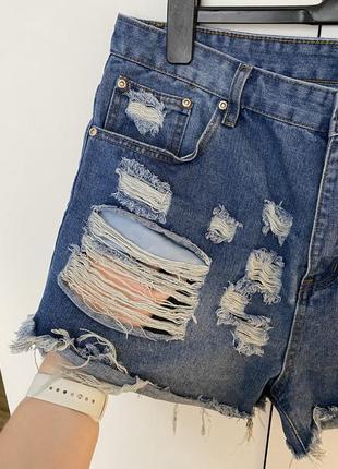 Короткие джинсовые шорты с рваностями дырками батал6 фото