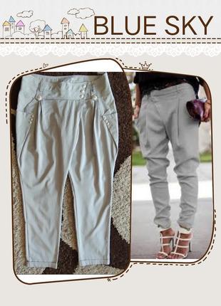 Очень стильные тонкие  брюки с отворотами
