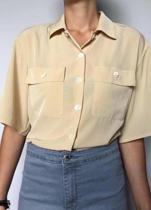 Стильная блуза с карманами