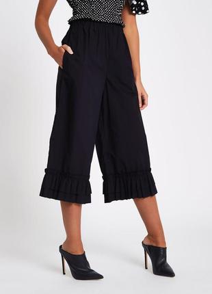 Кюлоты чёрные широкие в оборкой рюшами внизу штанины