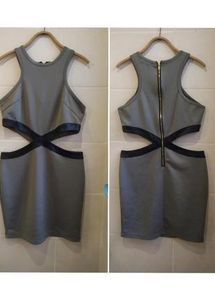 Красивое облегающее  платье с вырезами по бокам