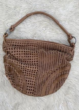 Плетёная дезайнерская сумка мешок с натуральной кожи
