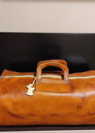 Большая рыжая дорожная кожаная сумка