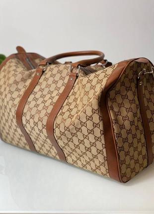 Дорожная  сумка бренд для спорта коричневая4 фото