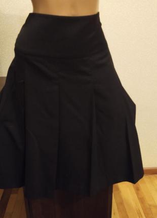 Удлиненная юбка с широкими защипами - складками