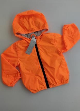 Яркая оранжевая легкая ветровка idexe италия вітрівка