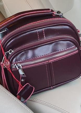 Жіноча шкіряна компактна сумочка-клатч