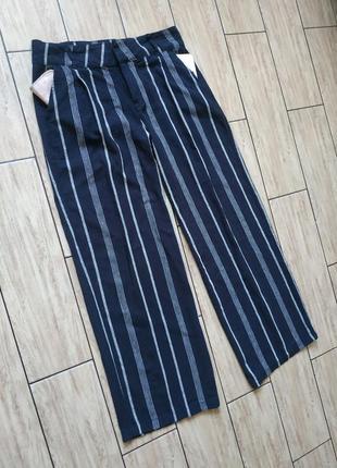 Натуральные льняные штаны свободного кроя с боковыми карманами