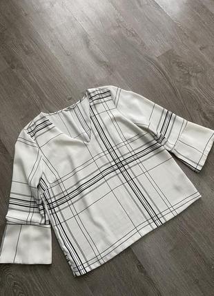 Стильная блуза в клетку свободного кроя